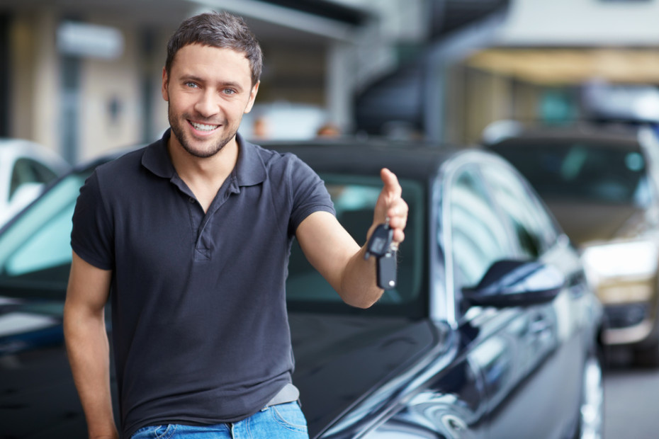 young man buying used car