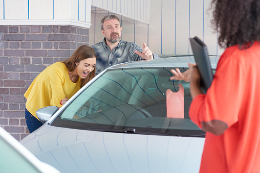 dad and daughter happy with affordable used cars