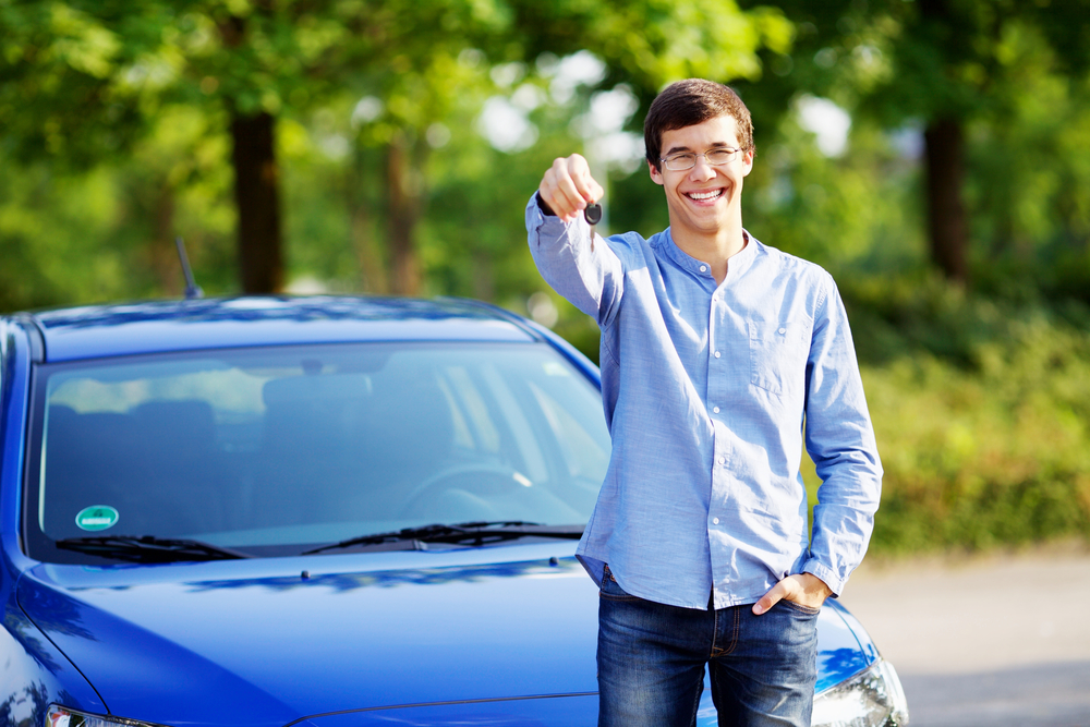 young man standing in used car lots in phoenix, used car lots in phoenix az