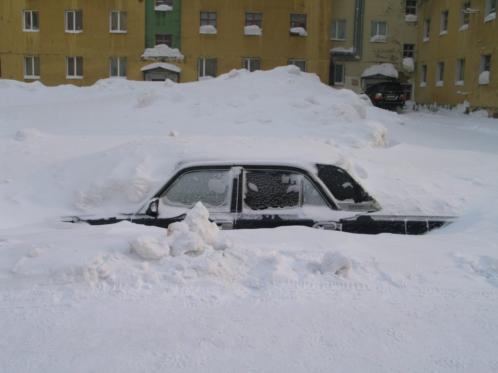 car buried in snow | arizona used car dealers