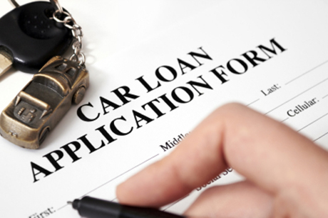 filling out car loan application form