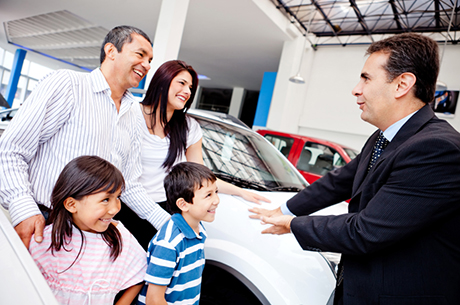 salesman speaking to family | Certified Pre Owned Dealership Articles