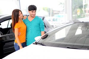 couple looking at Auto Action AZ Used Car Offers