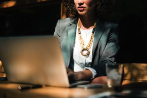 young woman on laptop | bad credit auto loans arizona